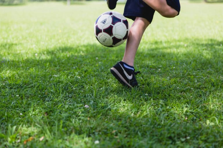 Close up of boy playing soccer
