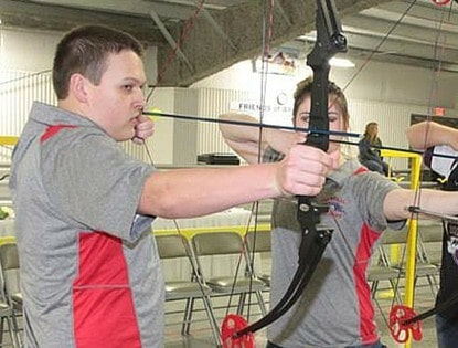Closeup of an archery tournament shooter